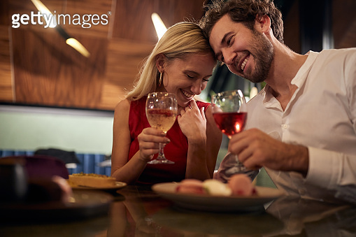 A young couple in romantic moments at Valentine's day celebration in restaurant. Together, Valentine's day, celebration