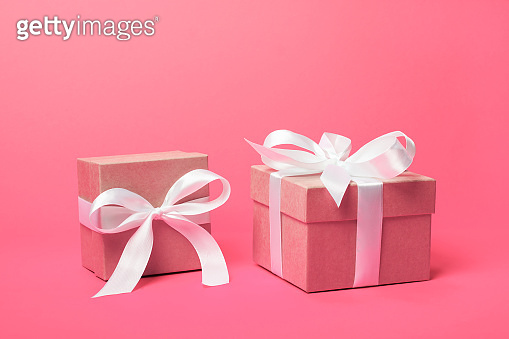Attractive gifts on the coral pink background