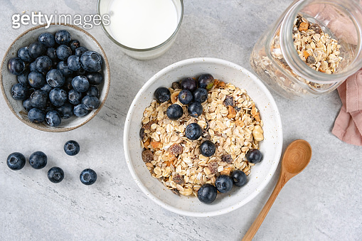 Granola or muesli in bowl with blueberries