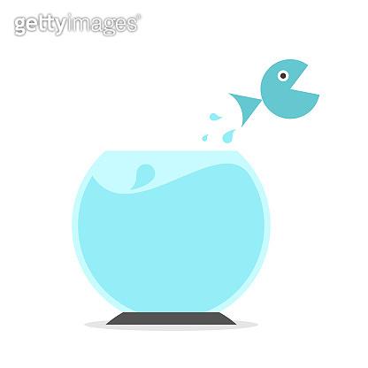 Fish jumping from fishbowl
