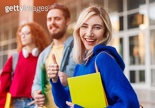 Cheerful student supporting university admission campaign