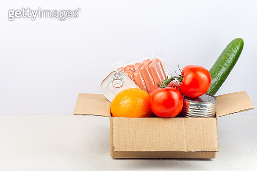 Carton box with food, food donation, delivery at home, horizontal, copy space