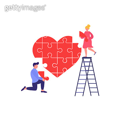 Man and woman hold heart puzzle piece. Couple in love.