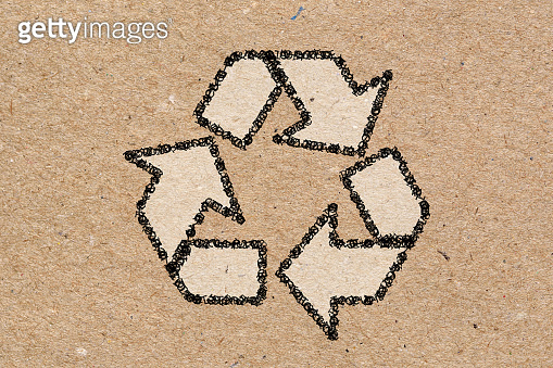 Recycling symbol on brown craft paper background.