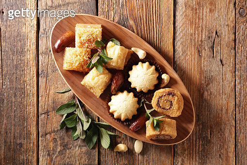 assorted of arabian baklava on wood background