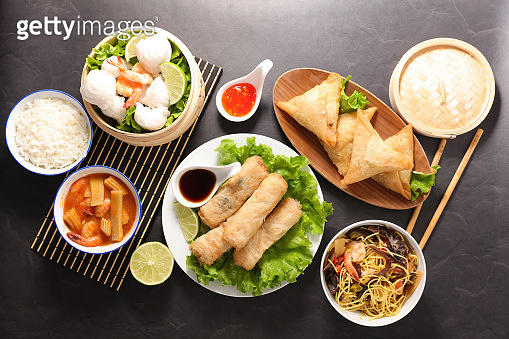assorted of asian food- spring roll, noodles soup, dim sum, fried noodles