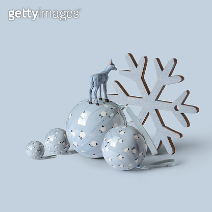 Blue Reindeer standing on Christmas balls, and snow star on blue background