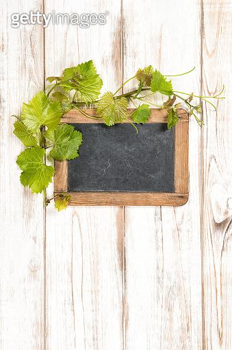 Chalkboard green vine leaves decoration wooden background