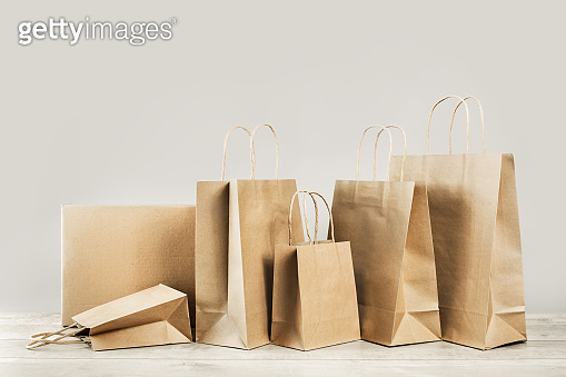 Assorted paper bags and boxes. Packages delivery