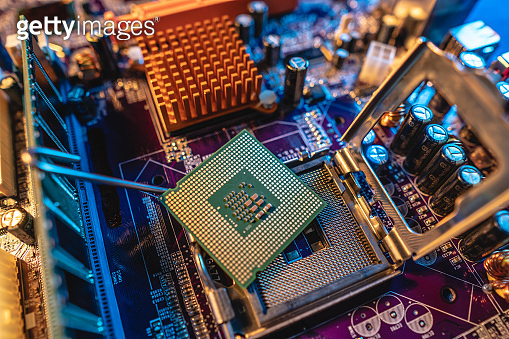 Modern processor CPU on the motherboard of the computer. Concept of technology hardware and repair in the neon light