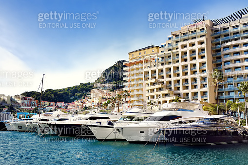 Principality of Monako. View of seaport with yachts and speedboats.