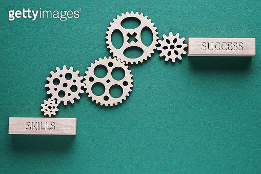 Abstract background with connected gears working together, from skills to success. Creative development process.