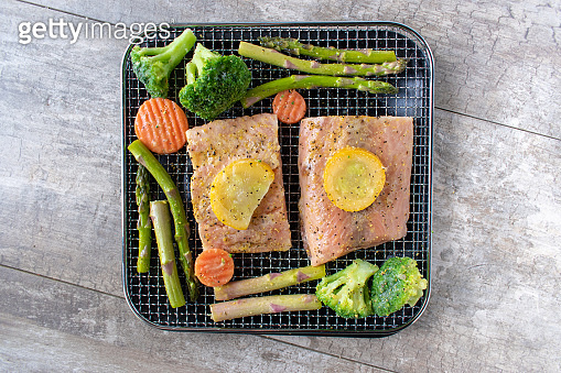 healthy home cooked dinner for two with salmon and vegetables