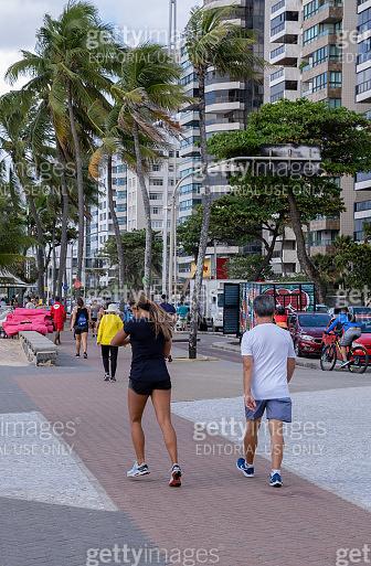 People strolling in Boa Viagem sidewalk