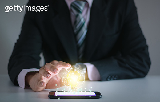 Light bulb new ideas with innovative technology solution concepts hands of the businessman.