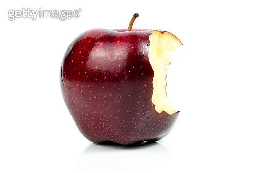 Fresh red apple nibble on a white background
