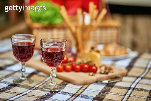Cozy autumn picnic in the park with wine on warm plaid