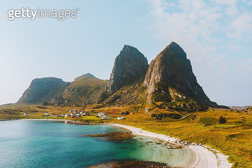Sea and sandy beach with mountain rocks view in Norway landscape Traena islands travel destinations amazing nature scenery