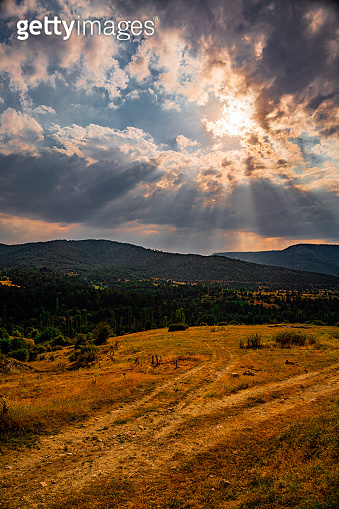 Wonderful landscape in mountains at sunset. Dramatic sky with colorful clouds over the hills.