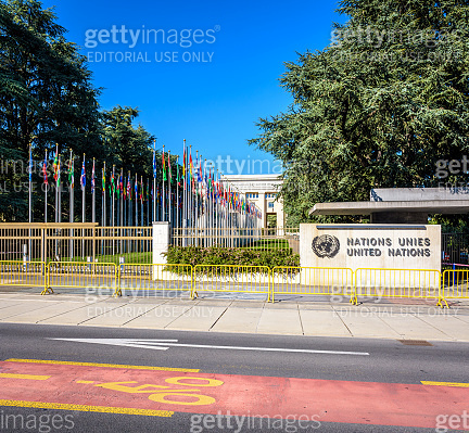 The avenue of flags at the entrance of the Palace of Nations in Geneva, Switzerland.