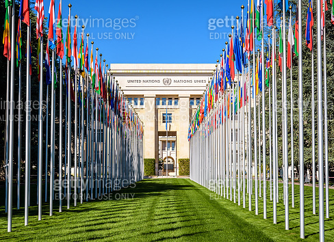 Avenue of flags and Palace of Nations in Geneva, Switzerland.