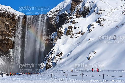 Skogafoss,Iceland - March 5, 2020: Amazing aerial winter landscape view of Skogafoss in Iceland.