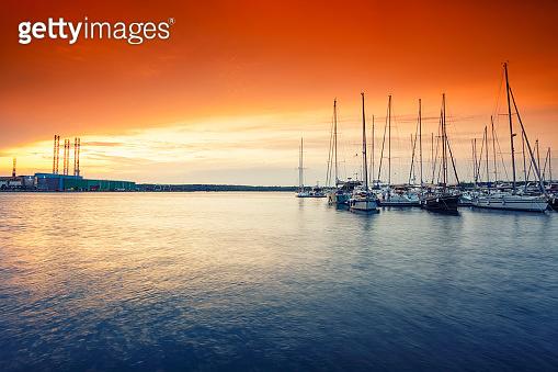 beautiful colorful morning sunlight over marina in Pula, Croatia.