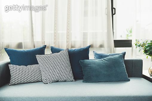 soft cozy pillows on modern sofa background home design concept