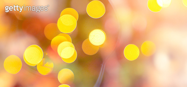 abstract image background of blur bokeh and crystal chandelier light equipment filter tone color effect