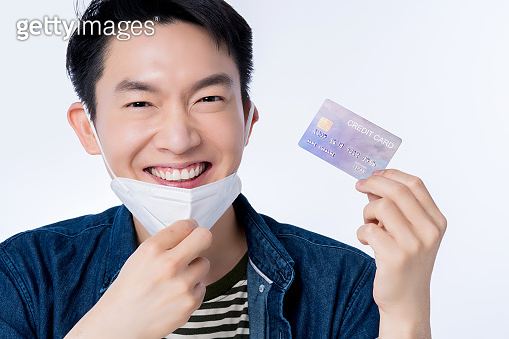 family healthy insurance concept happiness asian smart male smile with hand hold protection mask and credit card good deal gesture action