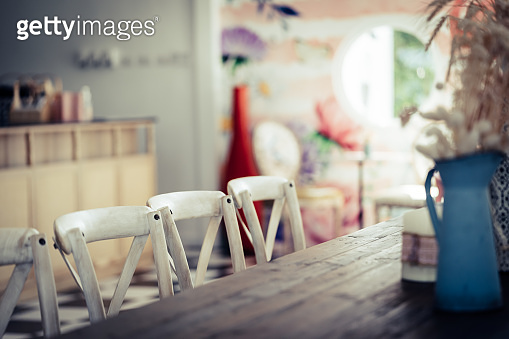 Empty wooden cafe table with flower vase for cafe restaurant backdrop and background.