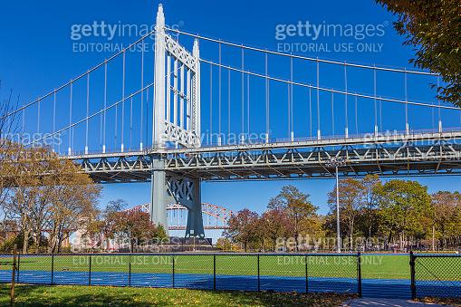 RFK Triborough Bridge with Hell Gate Bridge in background, New York, USA.
