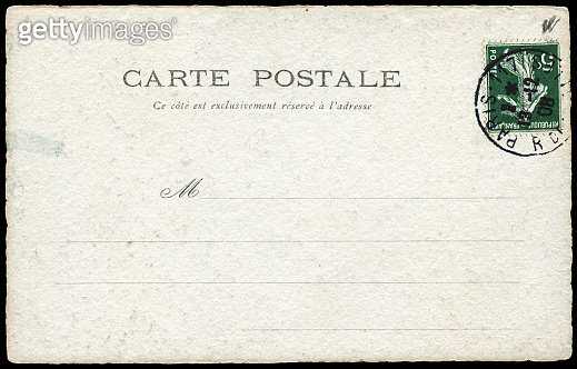 Vintage postcard sent from Paris, France in early 1900s, a very good background for any usage of the historic postcard communications.