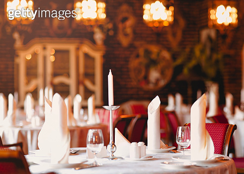 Festive table with candles in luxury restaurant
