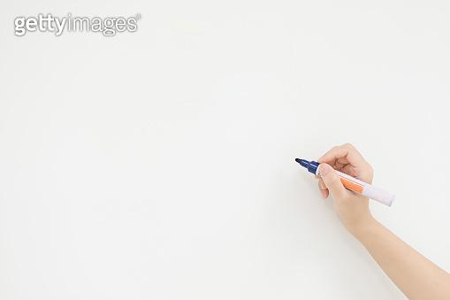 Teacher and blue pen on white board