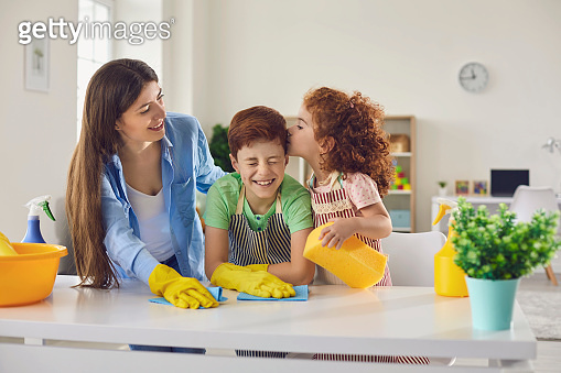 Mother and children are cleaning the house.