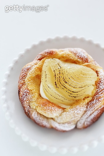 Marinated pear and custard pastry for gourmet dessert
