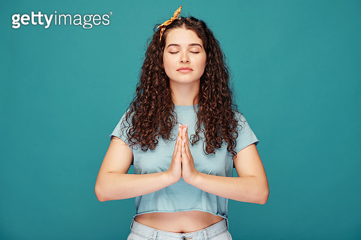 Calm girl meditating with closed eyes