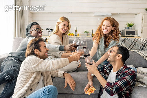 Friends Clinking Glasses With Wine
