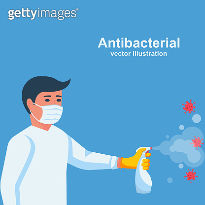 Antibacterial spray kills bacteria. Man holds bottle of antiseptic.