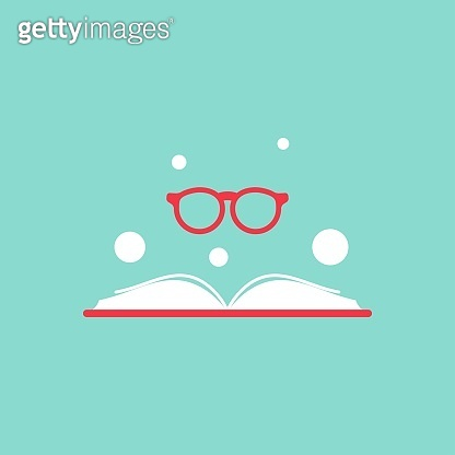 Opened book with red book cover and round red glasses on turquoise background.