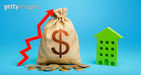 Dollar money bag with red up arrow and residential building. Recovery and growth in property cost. Increased return on investment. Increase in prices for apartments and housing. Municipal budget.