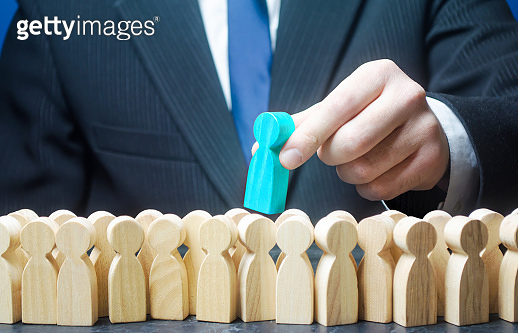 Employer chooses a blue person from the crowd of job candidates. Recruiting staffing. Headhunter HR. Search professionals specialists. Distribution of educational grants to promising people.
