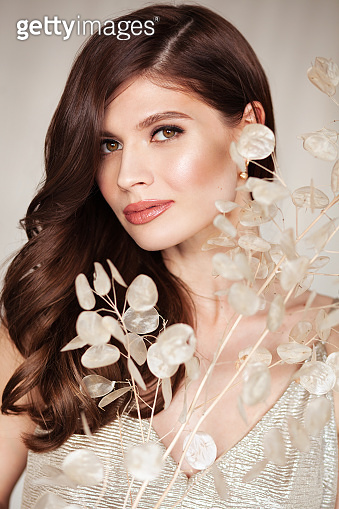 Elegant woman with beautiful hair and healthy skin