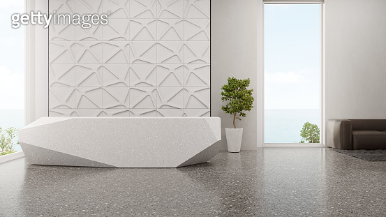 Luxury interior design of modern showroom with terrazzo floor and empty white tile wall background.