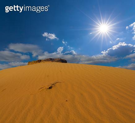 huge sandy dune under a sparkle sun, natural desert background