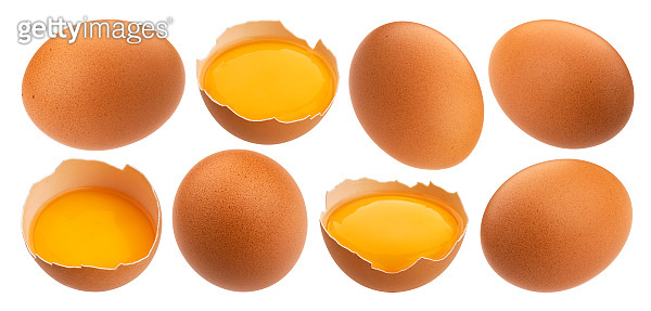 Whole and broken chicken eggs isolated on white background