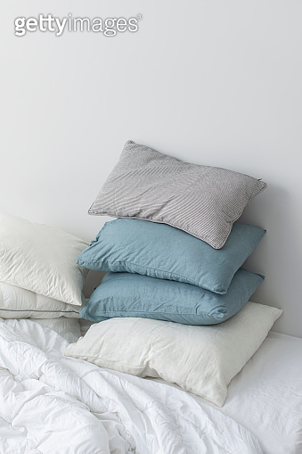 Stack of Pillows on a Bed