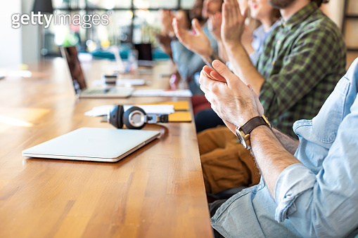 Praise and Support: a Group of Modern Businesspeople Clapping their Hands