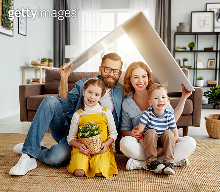 Happy family under fake roof in living room